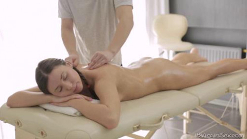 Relaxed Lesya enjoys the massage therapists big hands all over her ass.