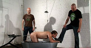 Arse screwed by a fuck machine, spanked, boot worship